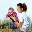 Youngl mather with beby outdoor — Stock Photo