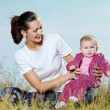 Beautiful mather with smiling beby on nature — Stock Photo #4094821