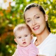 Happy mather with baby outdoor — Stock Photo #4094968