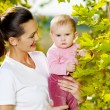 Happy mather with attractive baby outdoor — Stock Photo #4095017
