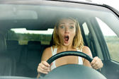Scared woman shouts driving the car — Zdjęcie stockowe