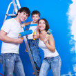 Happy family with paintbrush — Stok fotoğraf