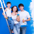 Smiling family with paintbrush — Stok fotoğraf