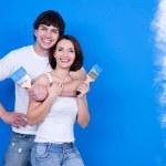 Happy couple with paintbrushes — Stock Photo