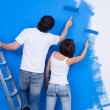 Stock Photo: Couple of painting wall