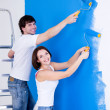 Smiling couple brushing the wall — Stock Photo #4101089
