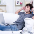 Man with laptop and headphone — Stock Photo