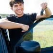 Happy mshowing keys near car — Stock Photo #4101311