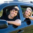 Happy young couple driving the car — Stock Photo #4101330
