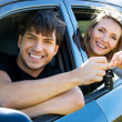 Foto de Stock  : Happy couple in new car