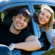 Stock Photo: Happy couple in new car