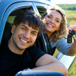 Happy couple in new car — Stock Photo