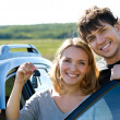 Happy couple near new car - Stock Photo