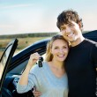 Happy couple near new car — Stock fotografie