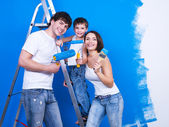 Happy family with paintbrush — Stock Photo