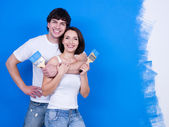 Happy couple with paintbrushes — Stock Photo