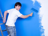 Happy man painting the wall — Stock Photo
