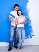 Happy cheerful couple of painters — Stock Photo