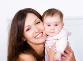 Portrat of happy mother with baby — Stock Photo