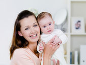 Happy woman with newborn child — Stock Photo