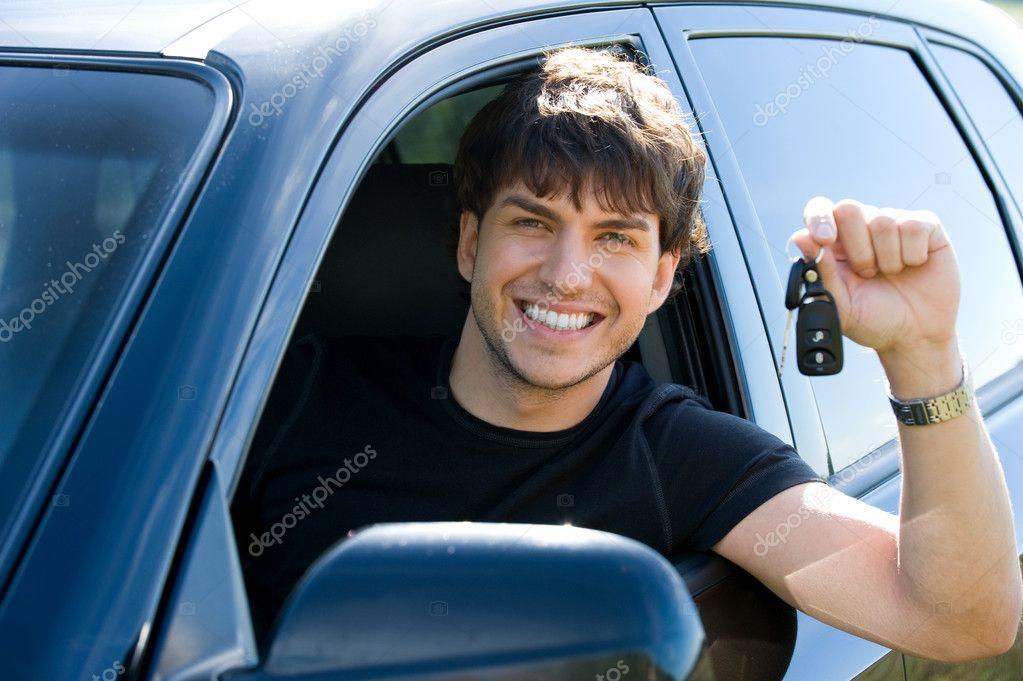 happy man showing keys in car stock photo valuavitaly 4101303. Black Bedroom Furniture Sets. Home Design Ideas