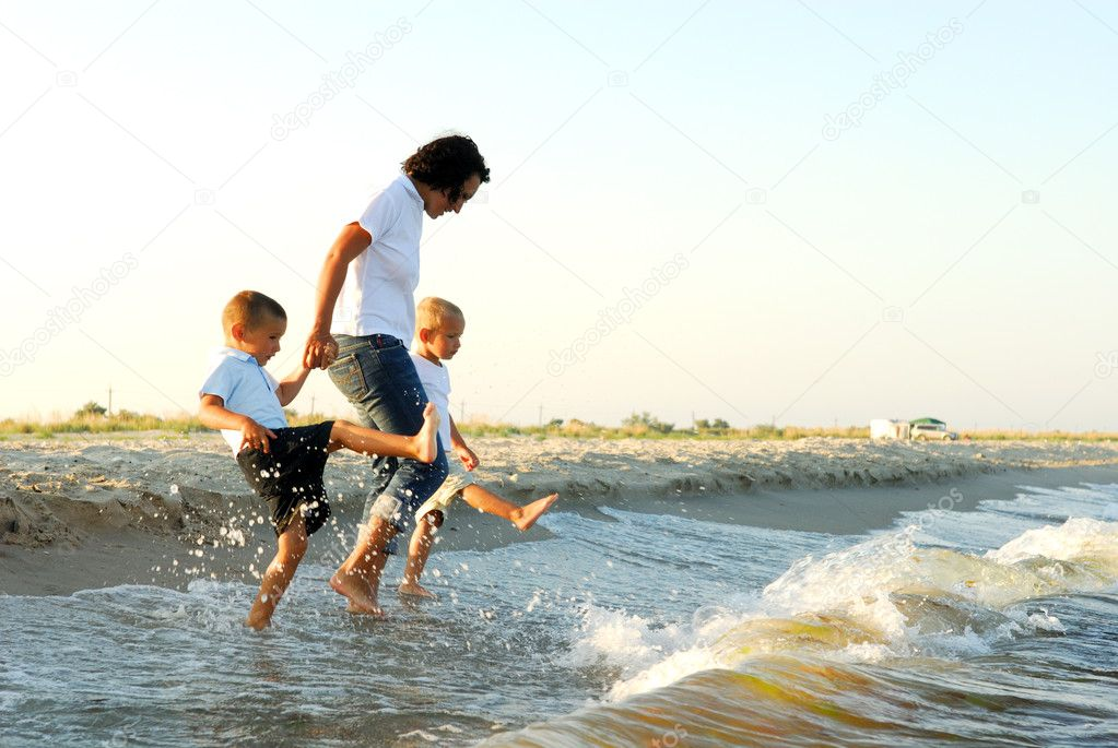 Young happy playing on sea beach — Stock Photo #4103657