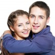 Embracing young happy beautiful couple — Stock Photo