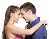 Happy couple embrace look against each other — Stock Photo