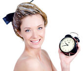 Woman with smile coloring hair holding alarm — Стоковое фото