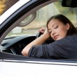 Young  woman sleeps in the car - Foto Stock