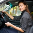 Young woman in the new car — Stockfoto