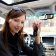 Successful woman with keys from car — Stock Photo
