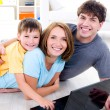 Family with son on the floor with laptop — Stock Photo #4236314