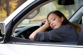 Young woman sleeps in the car — Stock Photo