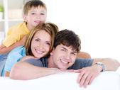 Happy smiling family of three — Stock Photo