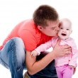 Young father kissing happy baby — Foto de Stock