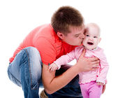 Young father kissing happy baby — Stock Photo