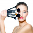 Portrait of the beautiful woman with make-up brushes — Stock Photo #4268237