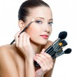 Pretty woman making make-up around the eyes. — Stock Photo #4268255
