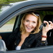 Beautiful happy woman in the new car with keys — Stock Photo #4305896