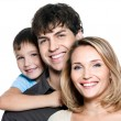 Happy young family with son — Foto de Stock
