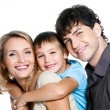 Happy young family with son - Stock Photo
