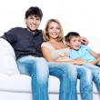 Happy young family with pretty child — Stock Photo #4306353