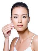 Woman pinching skin on her cheek — Stock Photo