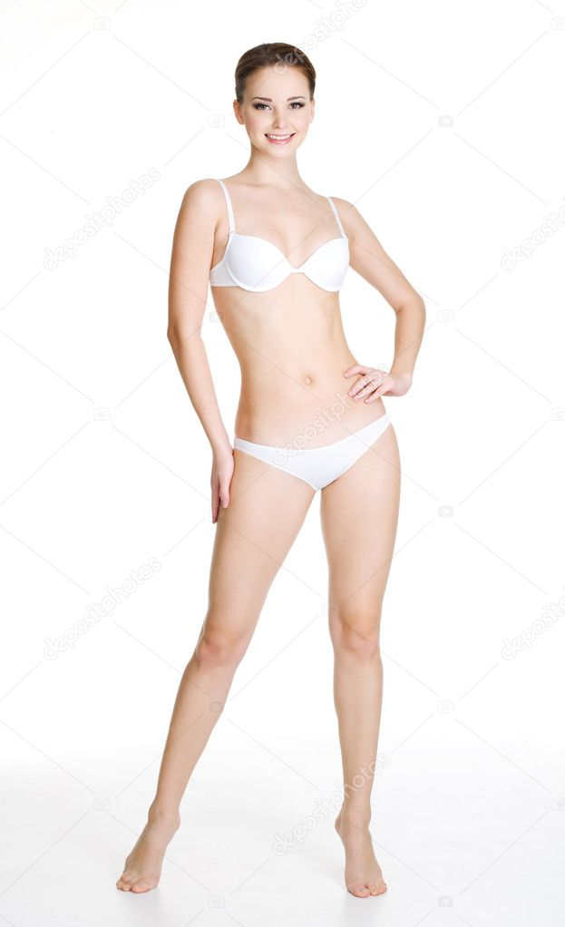 Happy young slim woman with beautiful perfect body posing on white background. Full-length portrait — Stock Photo #4431382