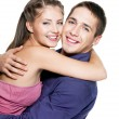 Embracing happy beautiful couple — Stock Photo #4484697