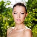 Beautiful fresh female face outdoors — Stock Photo