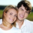 Happy beautiful couple on nature — Stock Photo #4595681