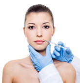 Botox injection in woman lips — Stock Photo