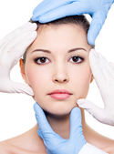 Plastic surgeons and beauty face — Stock Photo